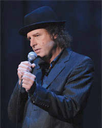 Steven Wright performing for his special When the Leaves Blow Away